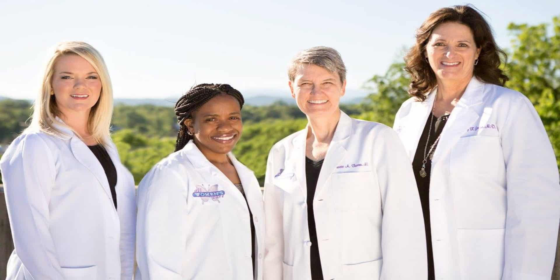 Our providers (L-R:Kelly Alsup, F.N.P.-C, Tasheema L. Fair, M.D.,  Tracie A. Traver, M.D. and Nancy F. Garza, M.D.) have been on both sides of the stethoscope and can understand and empathize with whatever you're facing on your life journey.
